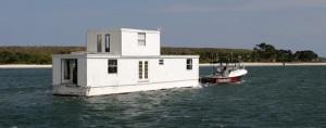 Lozman houseboat in transit.
