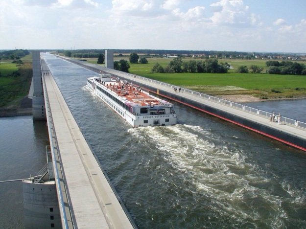 In Germany,  in 2003 the Magdeburg Water Bridge connected the Elbe-Haver Canal and the Mittelland Canal, saving time and distance in the transfer of cargo.